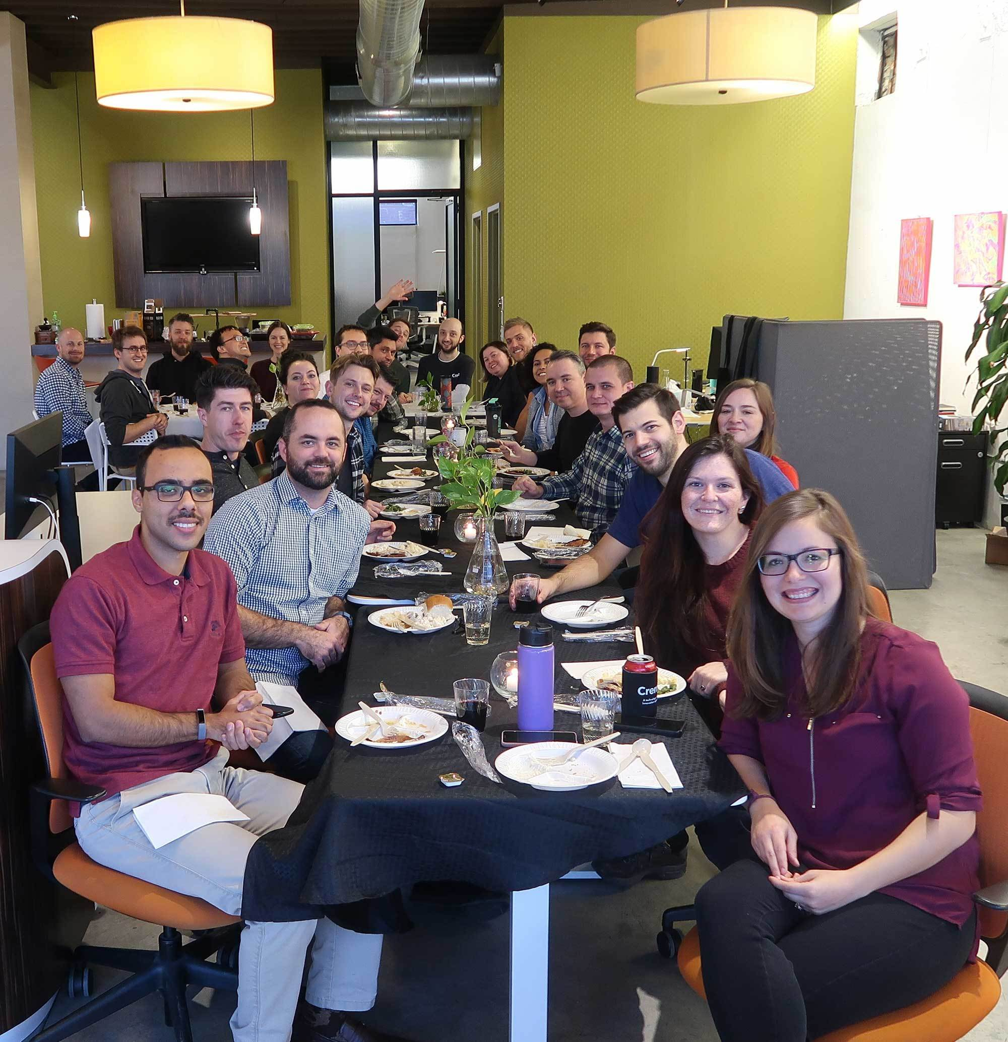 Photo of the Crema team having a meal together in the Crema office