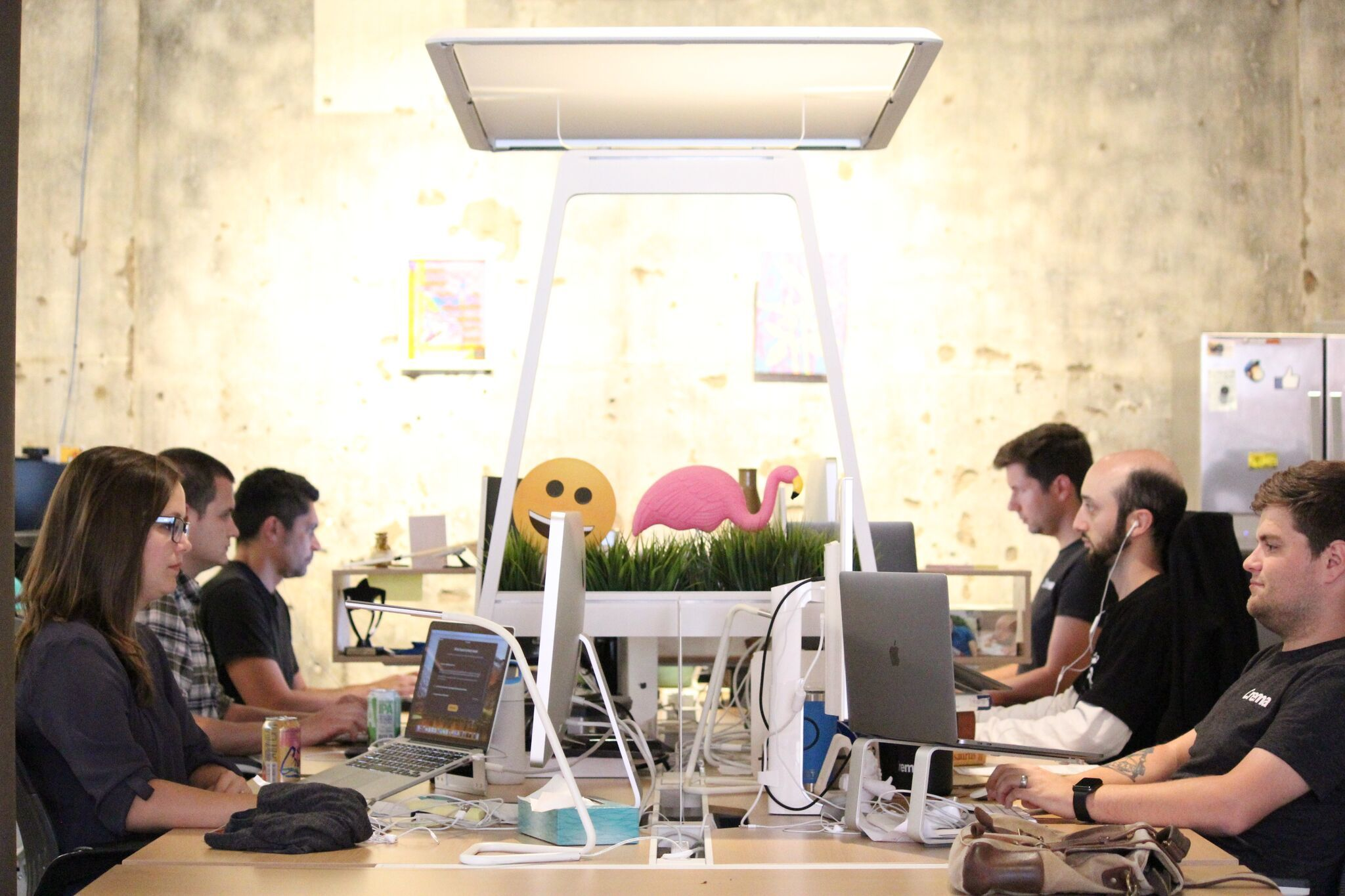 Photo of the team working together around a large table