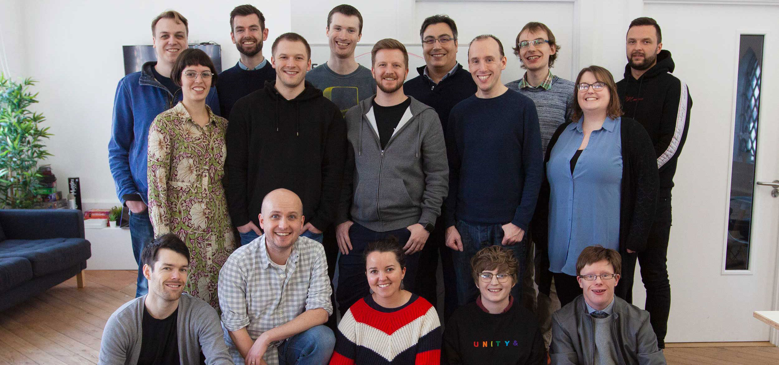 A photo of the 16 members Developer Society team in their studio